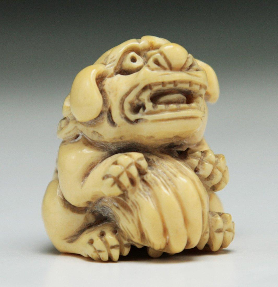 A Carved Antique Ivory Netsuke: Shi-shi