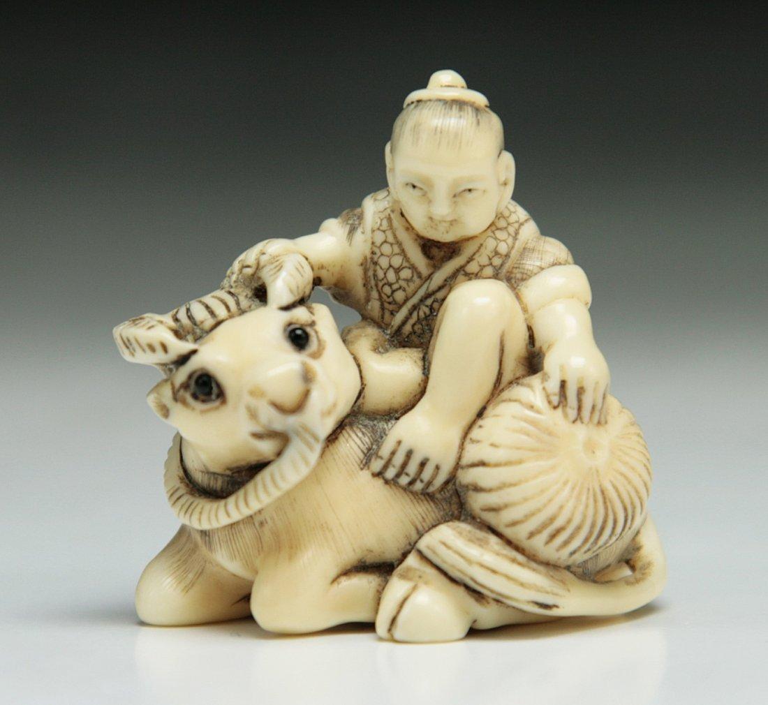 A Carved Antique Ivory Netsuke