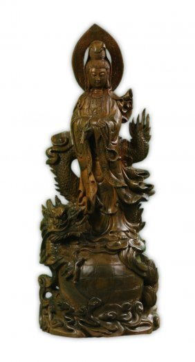 A Chinese Carved Tan Wood Guanyin