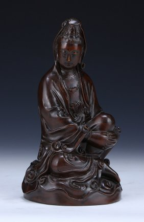 A Chinese Hardwood Carved Figure Of Guanyin