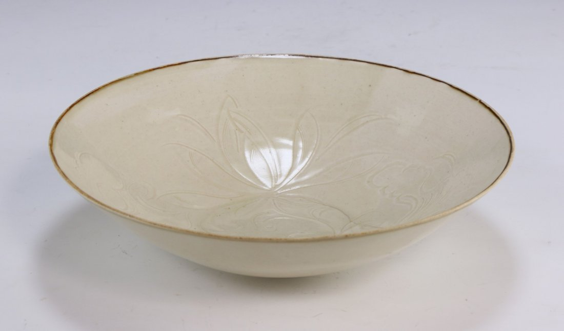 A Rare Dingyao Incised 'Daylily' Bowl