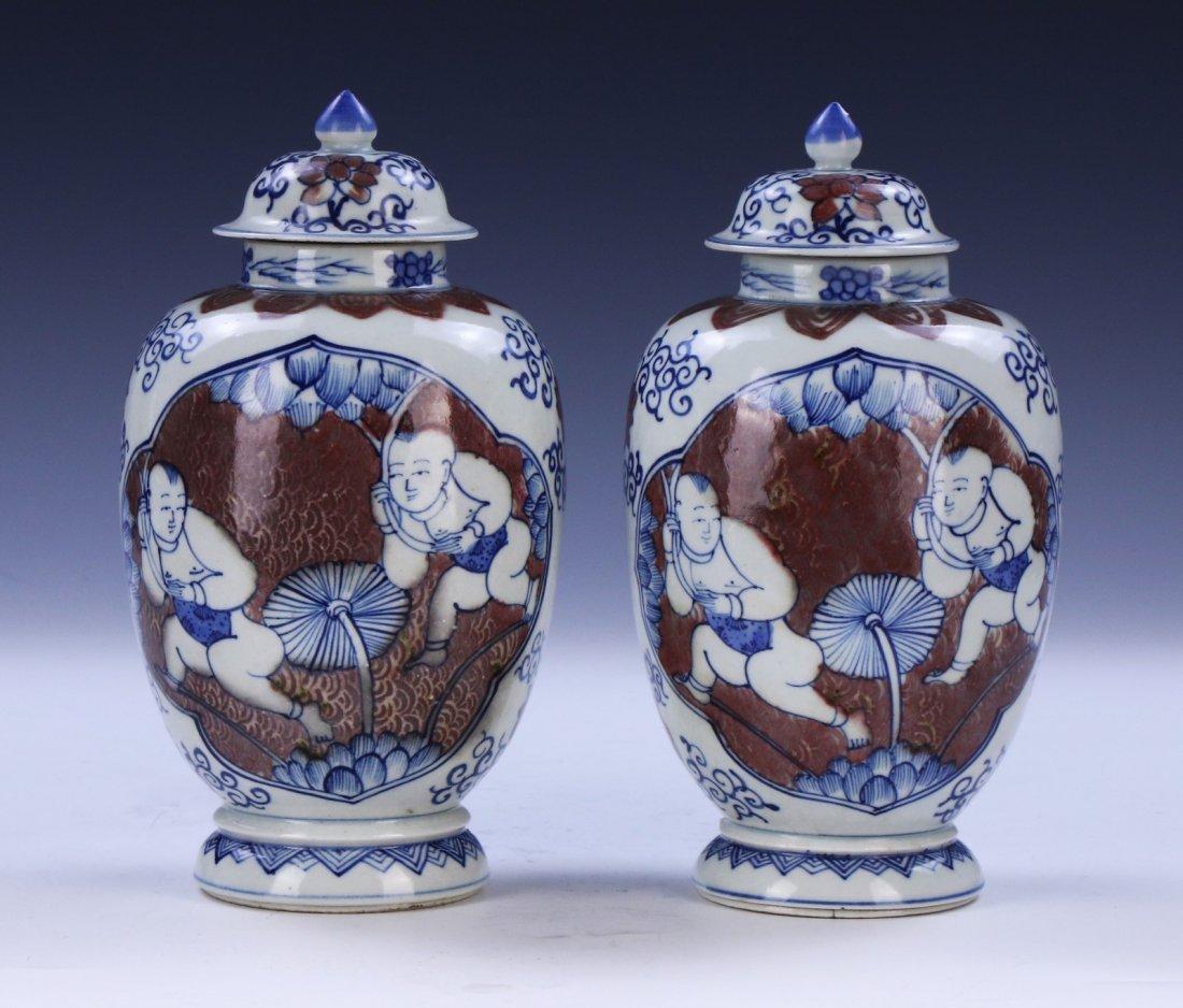 PAIR CHINESE ANTIQUE BLUE & WHITE UNDERGLAZED RED