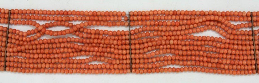 A TWELVE (12) STRAND MOMO RED BEADED CORAL NECKLACE - 2