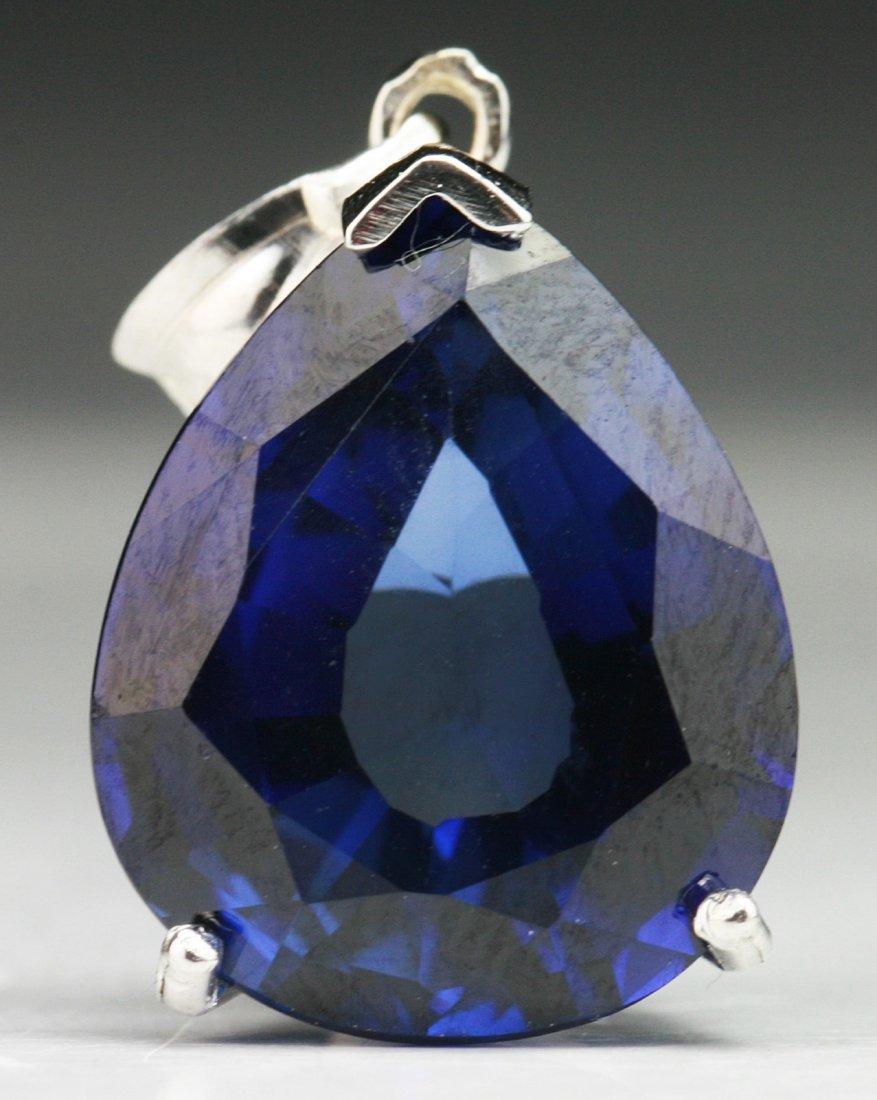 A Sapphire Pendant, 18K White Gold