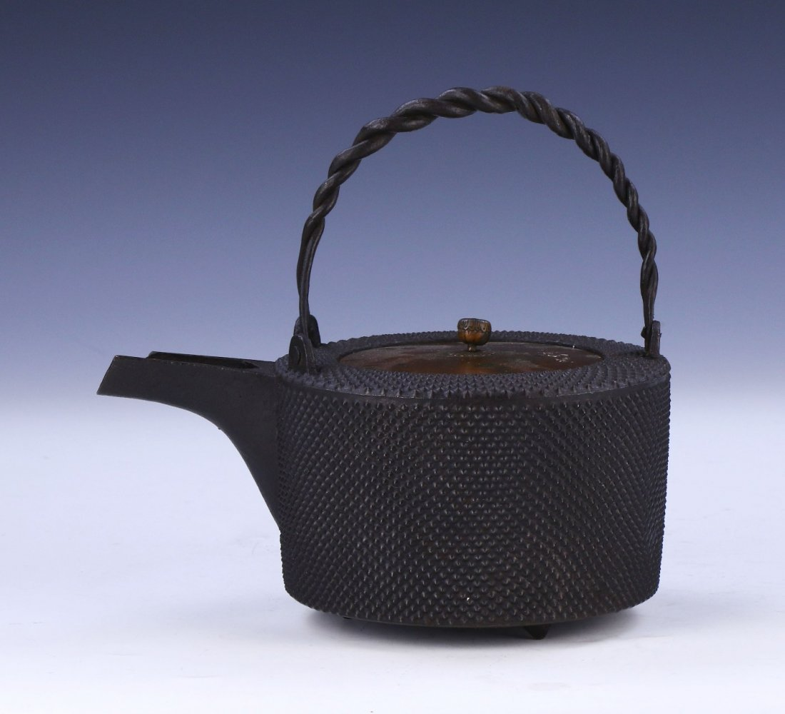 A JAPANESE ANTIQUE IRON TEAPOT