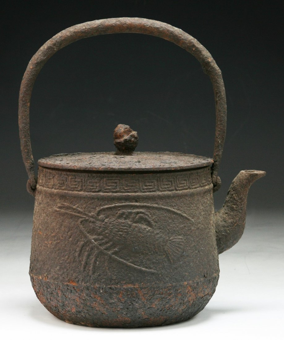 A JAPANESE ANTIQUE IRON TEAPOT WITH COVER