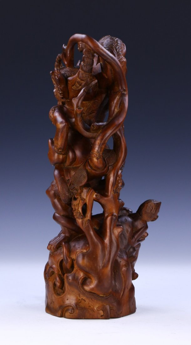 AN INDIAN CARVED WOOD FIGURE - 2
