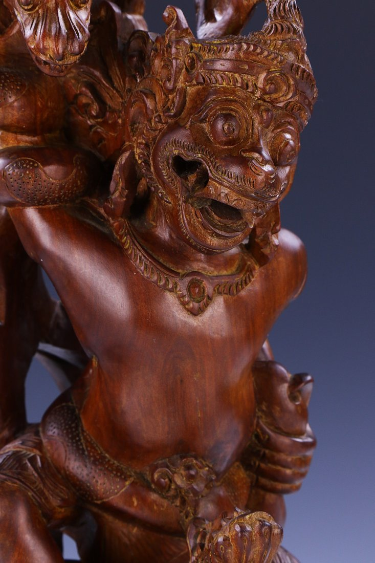 AN INDIAN CARVED WOOD FIGURE - 3