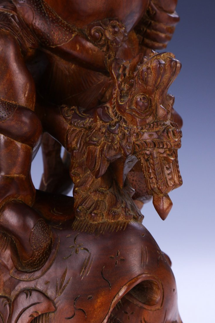 AN INDIAN CARVED WOOD FIGURE - 5