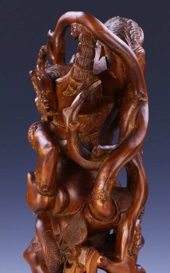 AN INDIAN CARVED WOOD FIGURE - 7