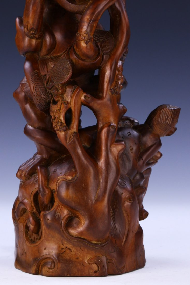 AN INDIAN CARVED WOOD FIGURE - 8