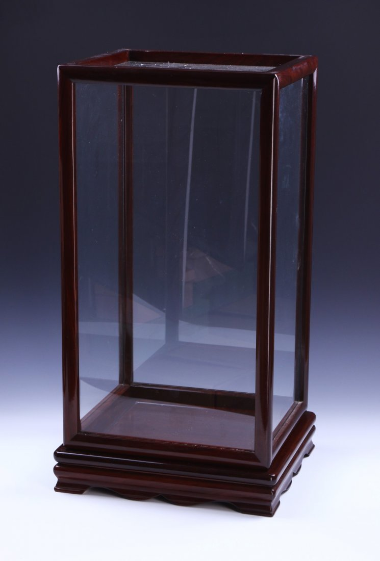 A WOOD CARVED DISPLAY CASE