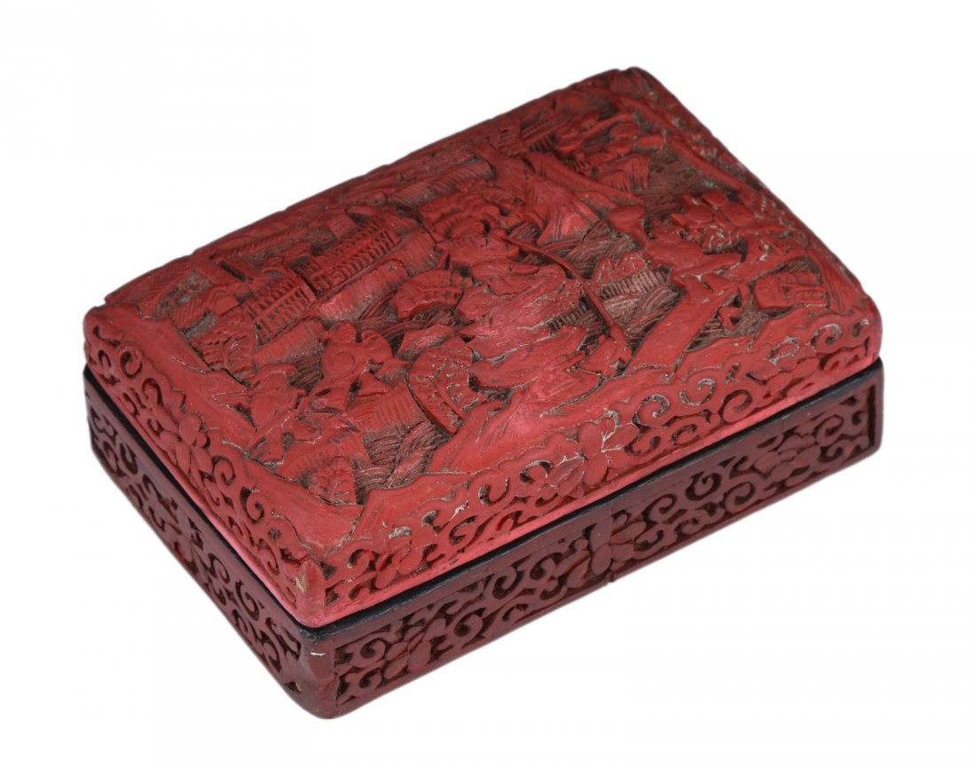 A CHINESE RED CINNABAR LACQUER LIDDED CASE