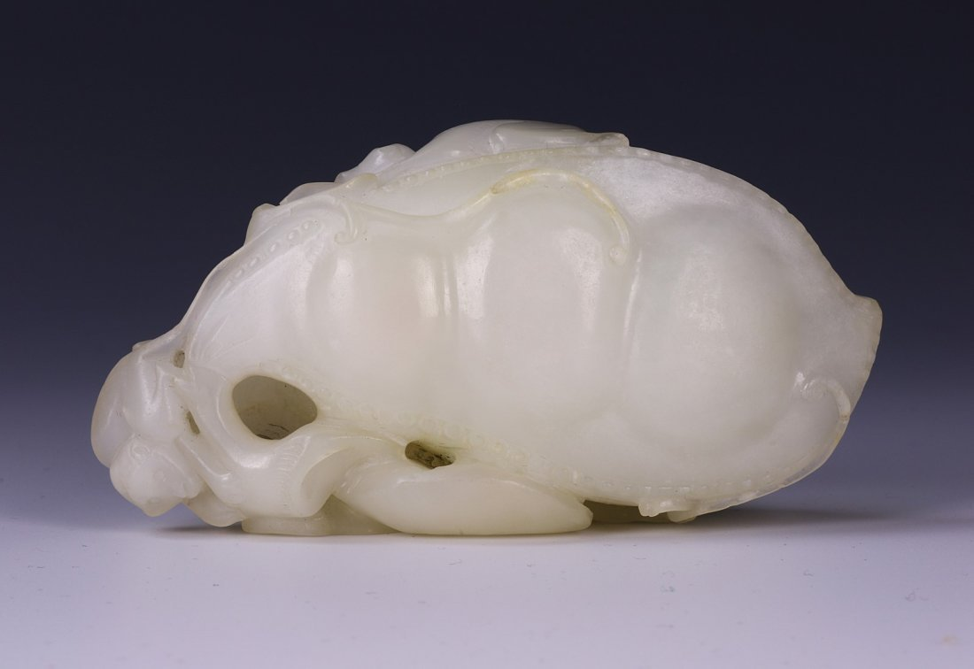A WHITE JADE PEA POD CARVING