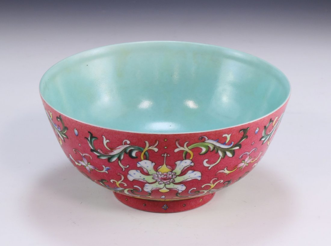 A FINE AND RARE CORAL-GROUND FAMILLE ROSE FLORAL BOWL