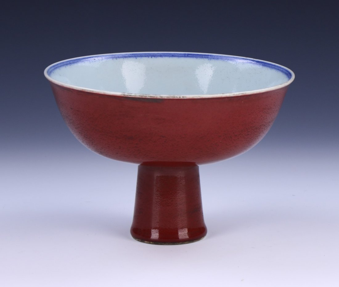 A CHINESE ANTIQUE OX BLOOD PORCELAIN STEM BOWL