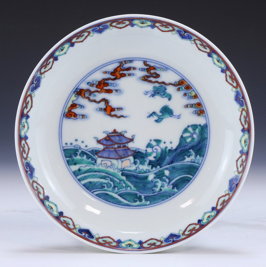 A CHINESE ANTIQUE DOUCAI PORCELAIN SAUCER
