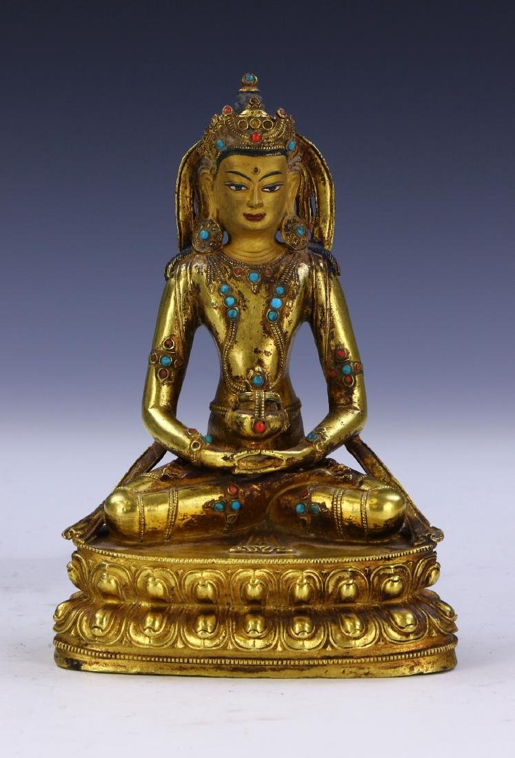 A TIBETAN ANTIQUE JEWELED GILT BRONZE BUDDHA