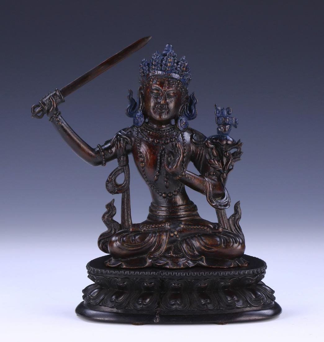A CHINESE ANTIQUE CHENGXIANG WOOD CARVED BUDDHA