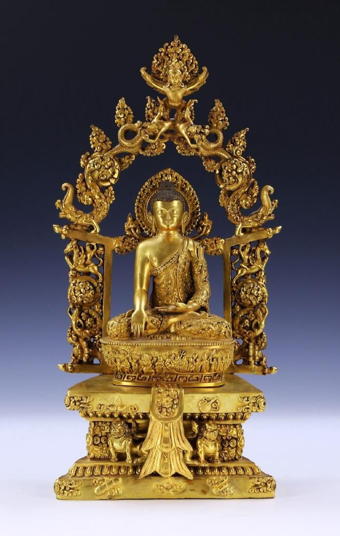 A RARE ANTIQUE GILT-BRONZE FIGURE OF BUDDHA SAKYAMUNI