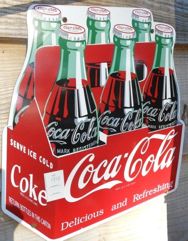 99: Porcelain / Metal Coca Cola Sign it measures 1 ft 5