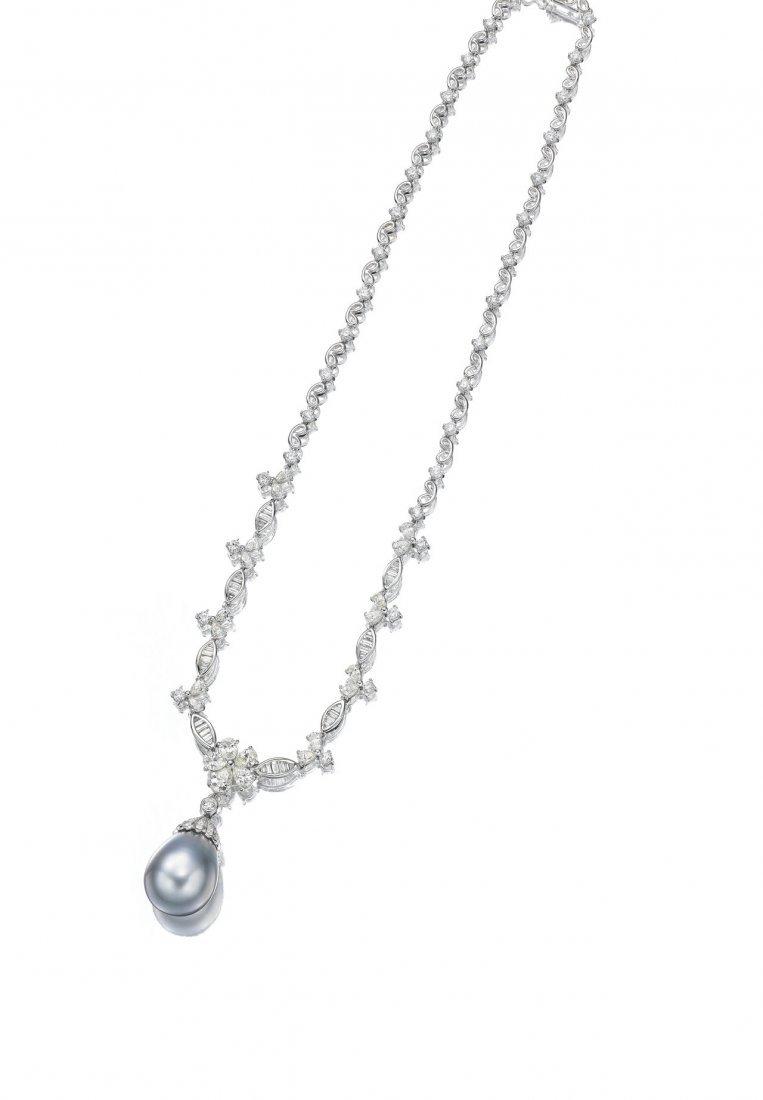 A CULTURED PEARL & DIAMOND PENDANT NECKLACE