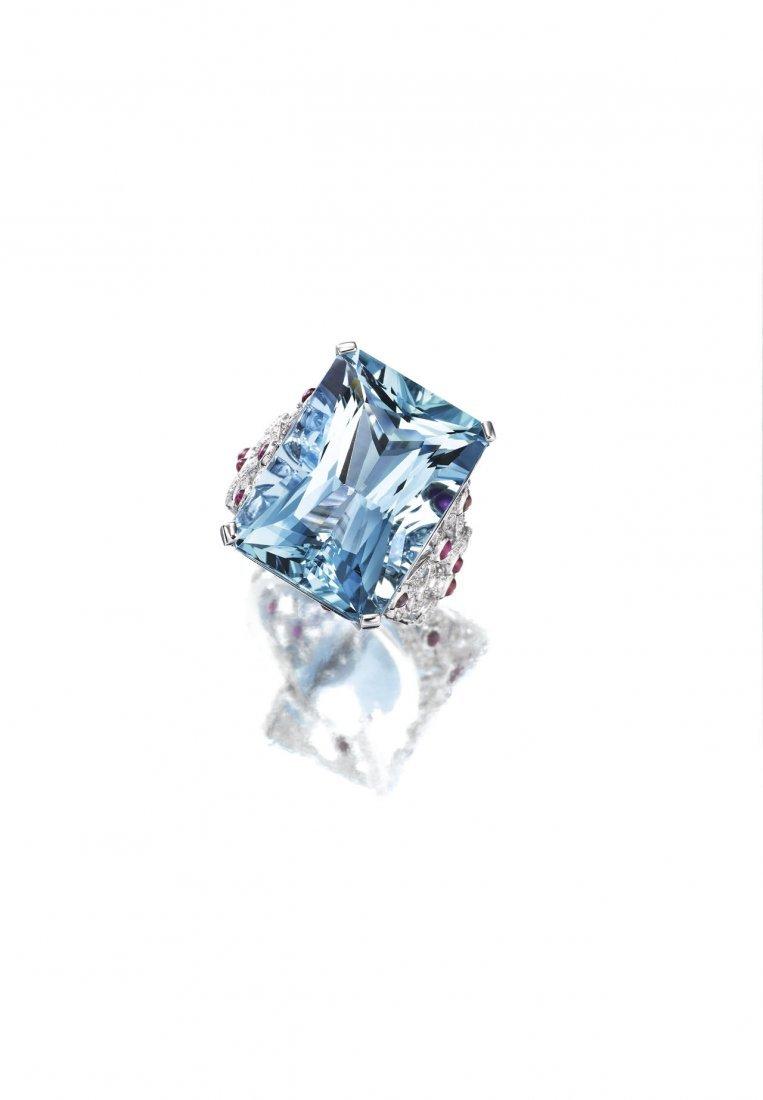 AN AQUAMARINE, DIAMOND & RUBY RING