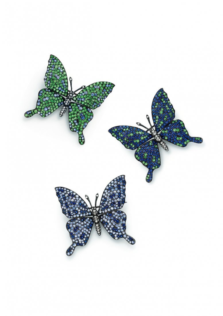 A SET OF MULTI-GEM AND DIAMOND BROOCHES