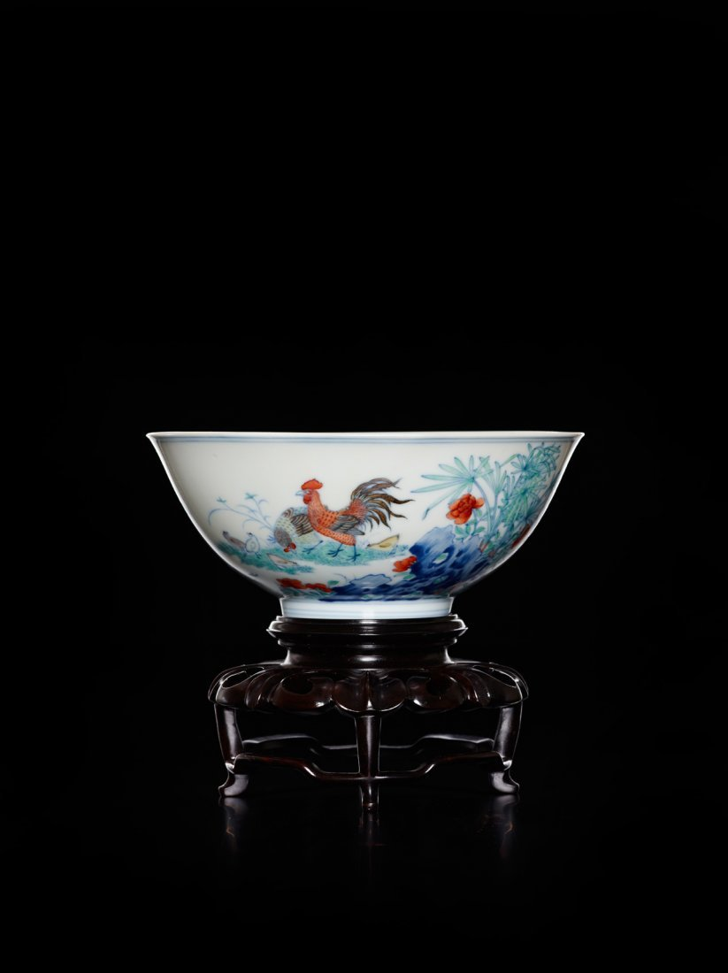 A BOWL WITH DESIGN OF CHICKENS