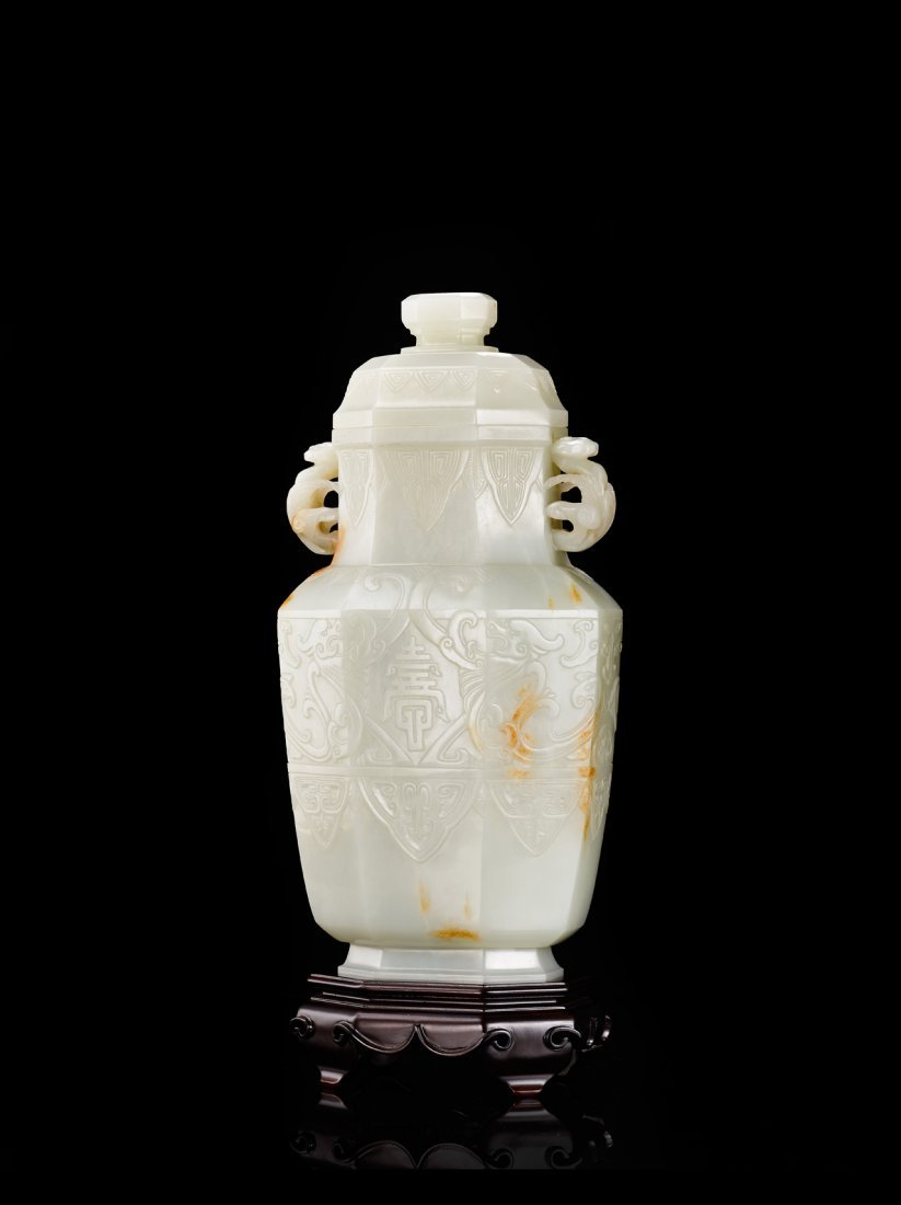 A RARE WHITE JADE SHOU CHARACTER VASE AND COVER