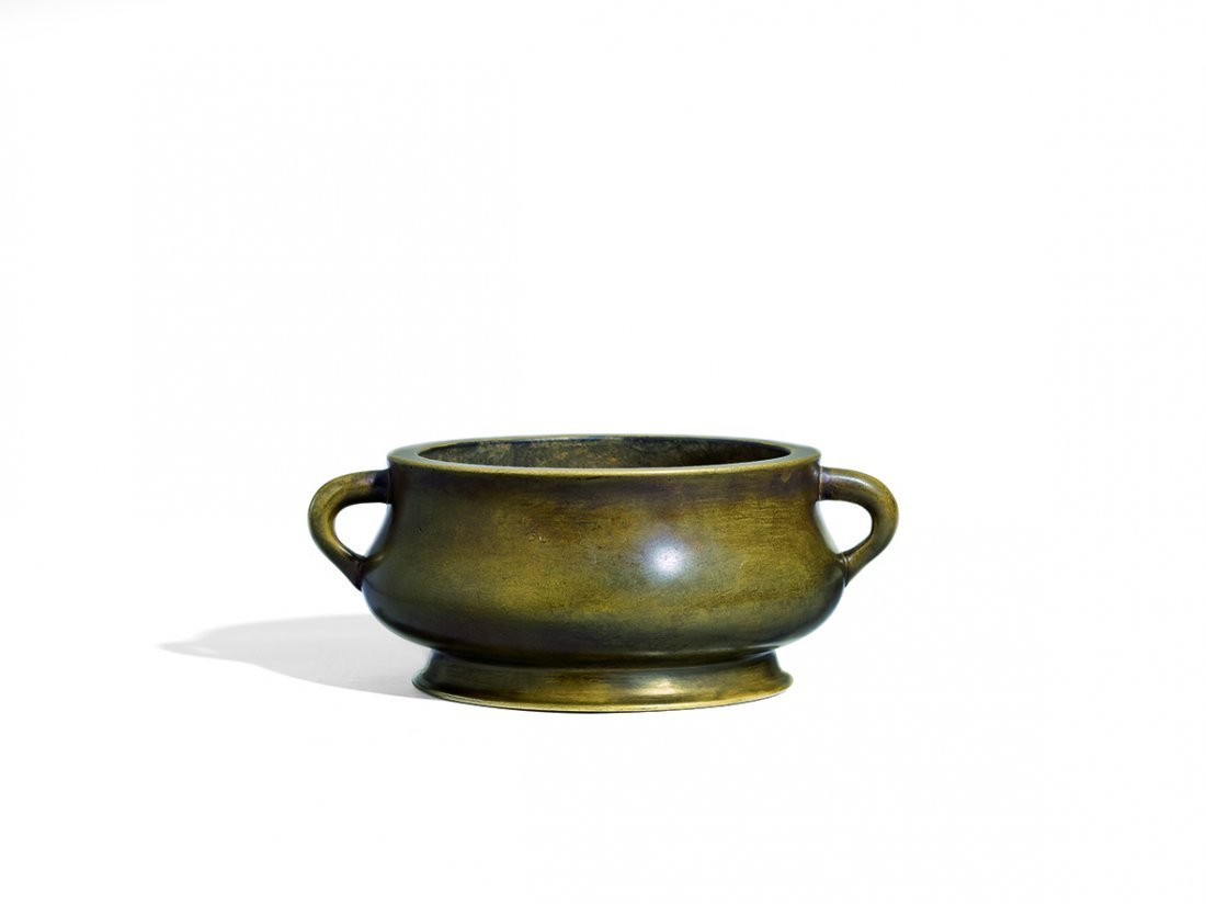 A BRONZE DRAGON EARS CENSER