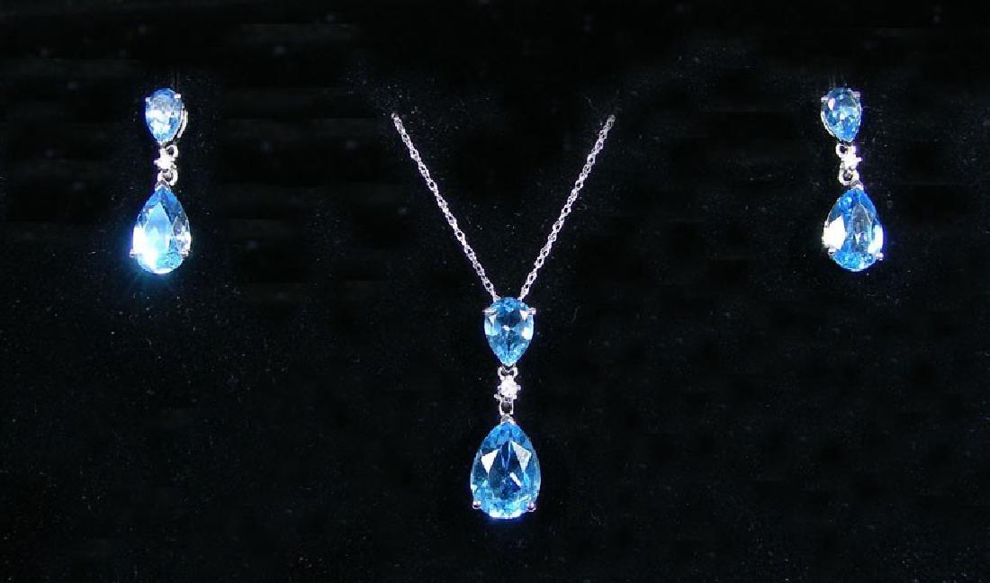 LADIES 14K W. G., BLUE TOPAZ & DIAMOND NECKLACE &