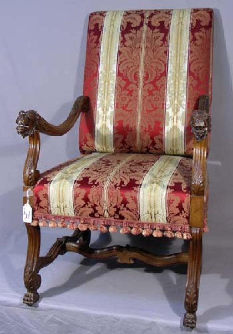 ANTIQUE HAND CARVED AND UPHOLSTERED ARMCHAIR
