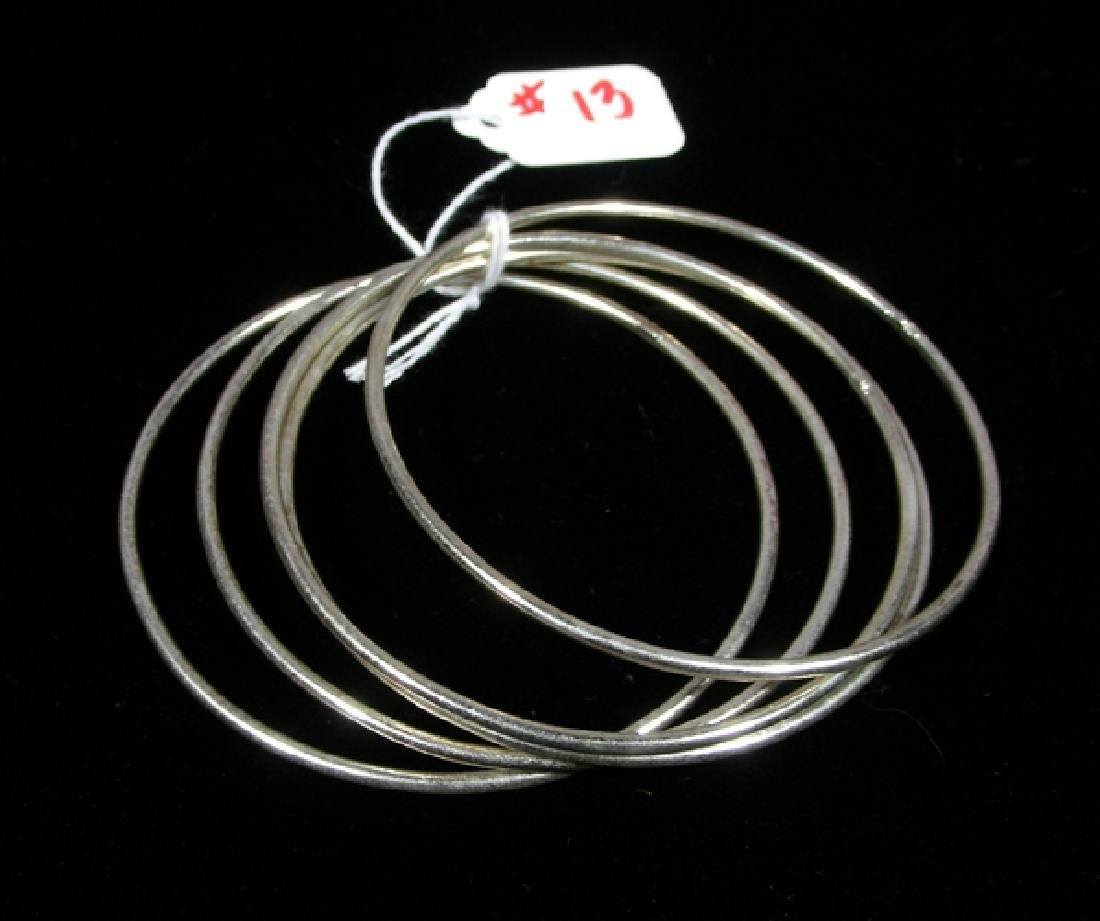 GROUP OF FIVE STERLING SILVER BANGLE BRACELETS