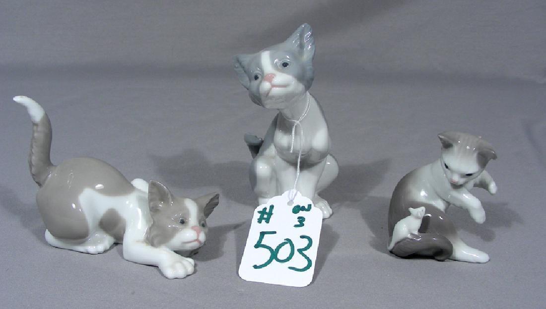THREE LLADRO PORCELAIN CAT SCULPTURES