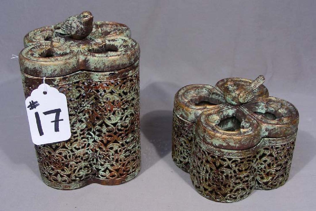 TWO ORNATE METAL AND MIRRORED BOXES.