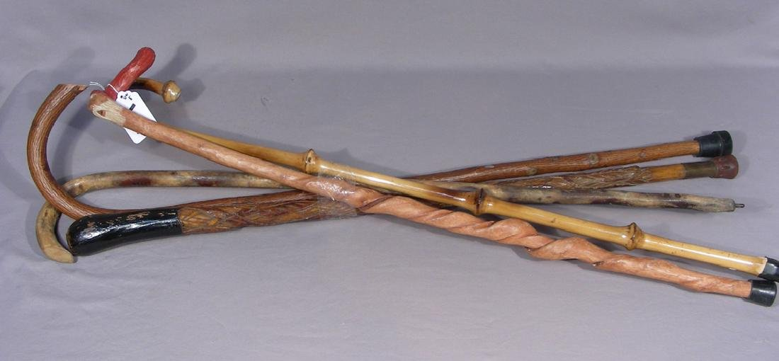 GROUP OF FIVE VINTAGE HAND CARVED WOODEN CANES