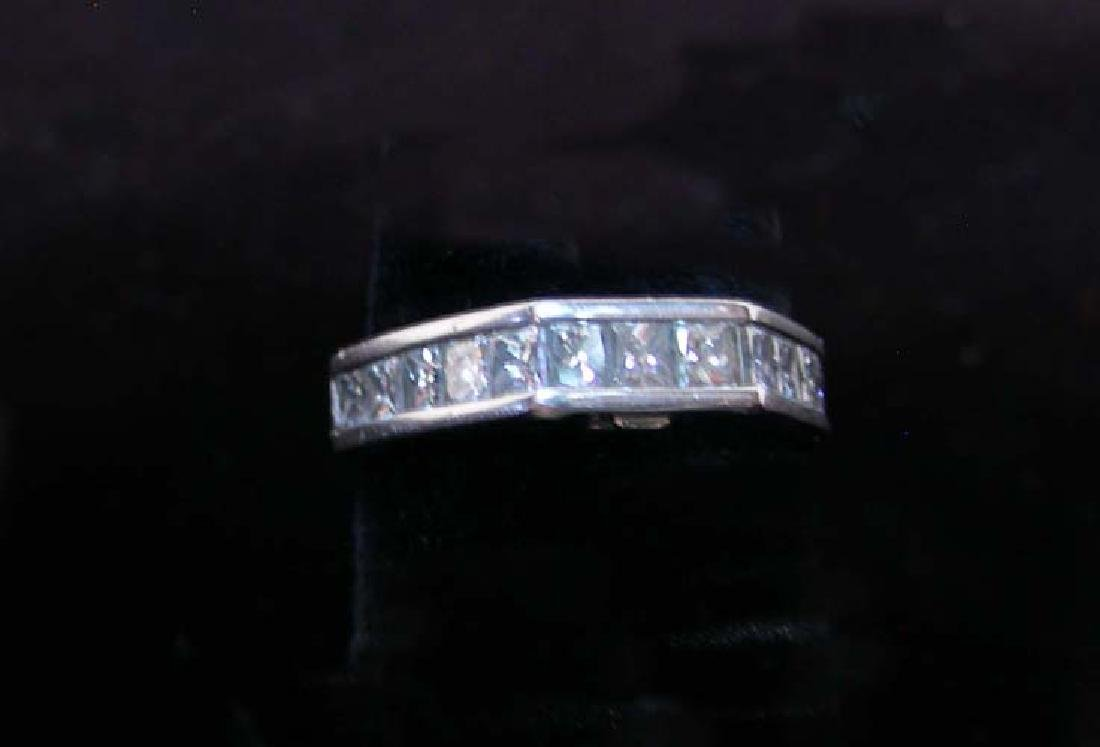 LADIES FINE PLATINUM AND DIAMOND BAND RING