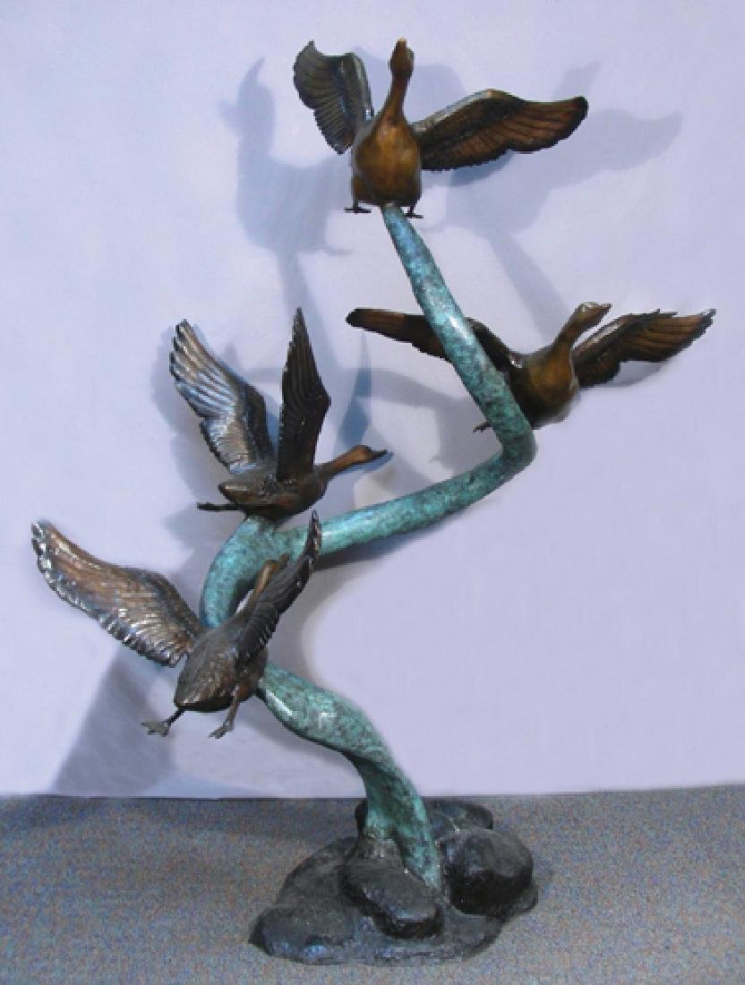 OUTSTANDING LIFE SIZE BRONZE SCULPTURE OF FLYING DUCKS