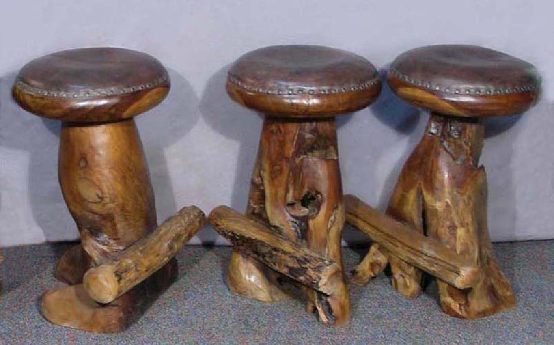 THREE UNUSUAL CUSTOM MADE TEAK AND LEATHER BAR STOOLS
