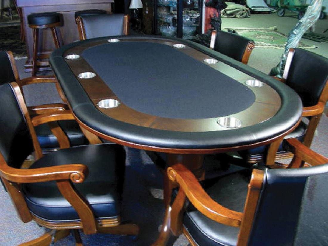 CARVED WOOD AND LEATHER GAME TABLE WITH SIX MATCHING