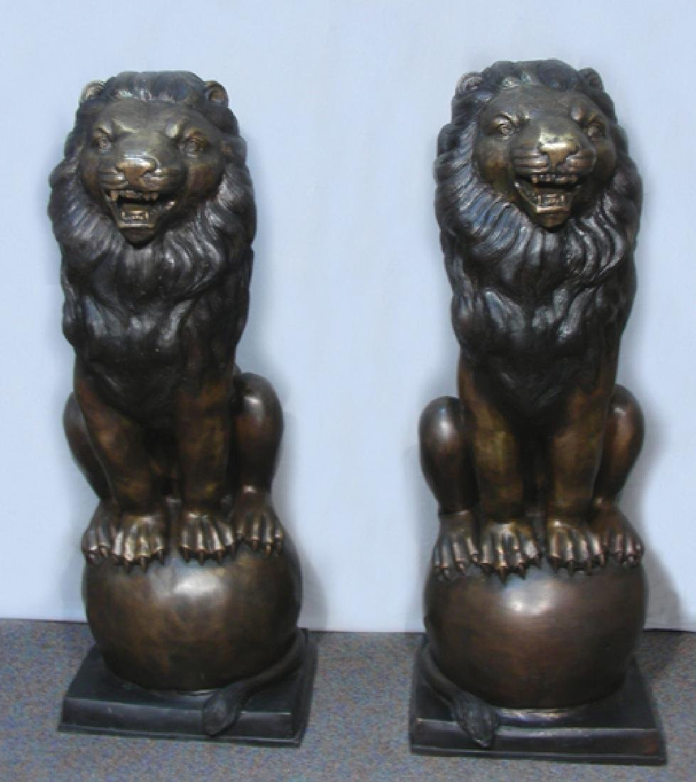 OUTSTANDING LARGE PAIR OF BRONZE SEATED LIONS
