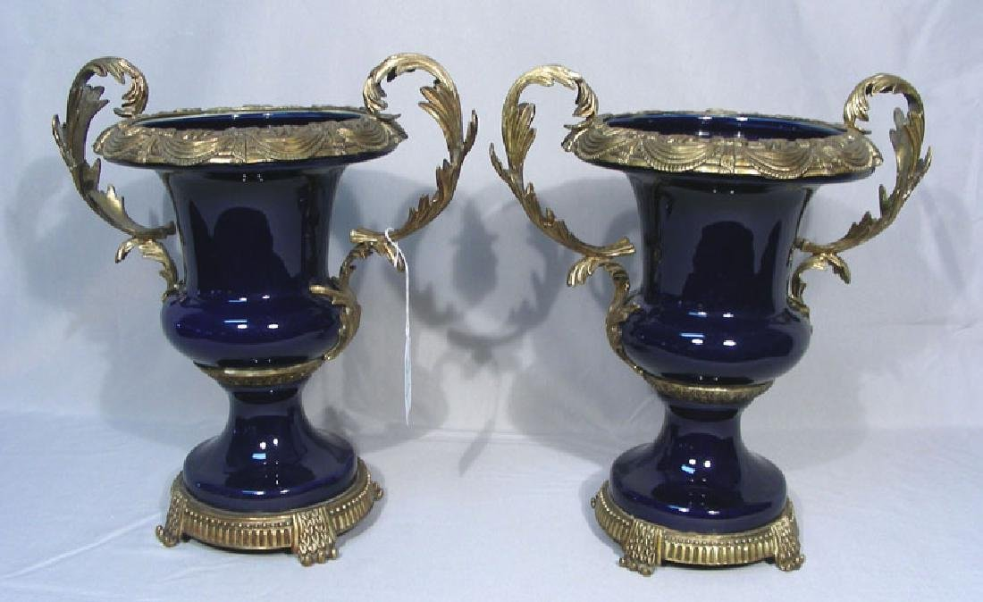 PAIR FRENCH BRONZE AND PORCELAIN URNS