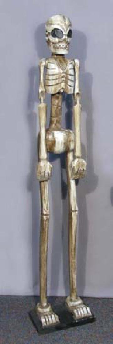 TALL CARVED WOODEN SKELETON