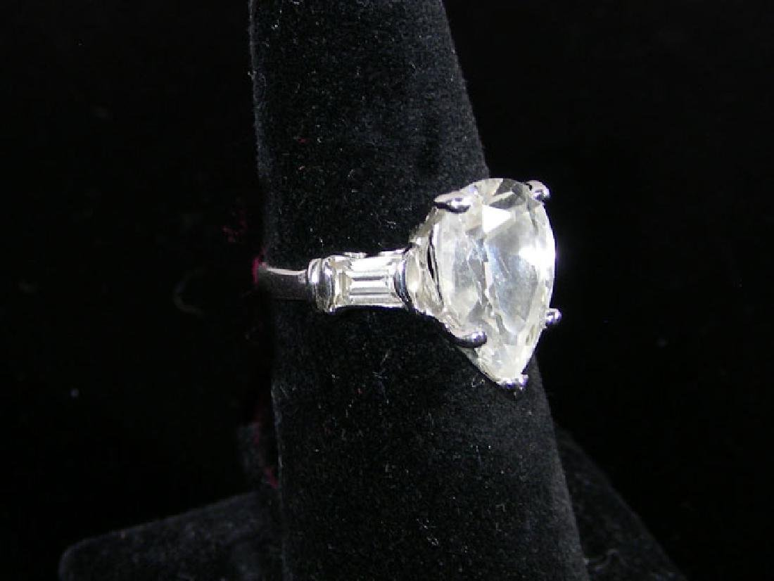 LADIES STERLING SILVER AND PEAR SHAPED CZ RING