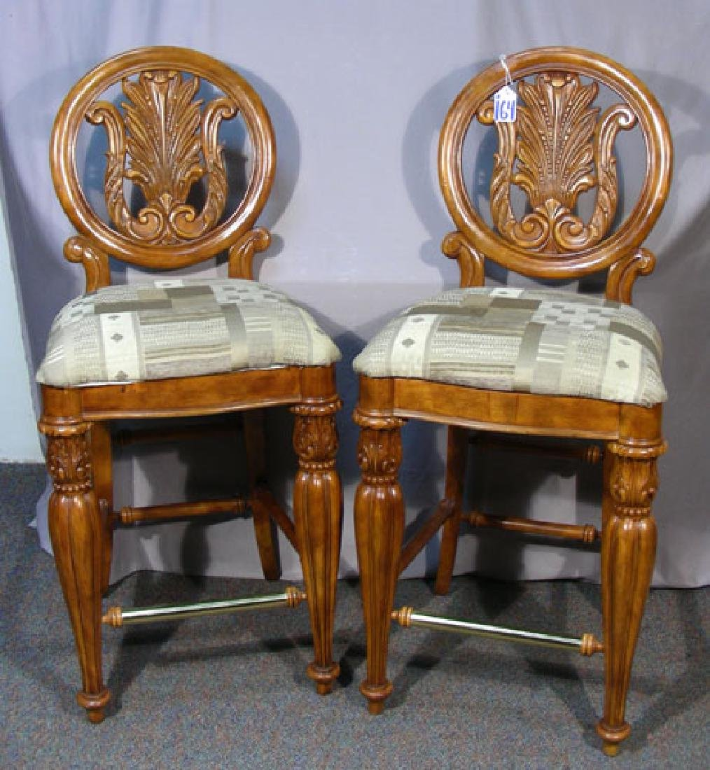 PAIR HAND CARVED WOOD AND UPHOLSTERED BAR STOOLS
