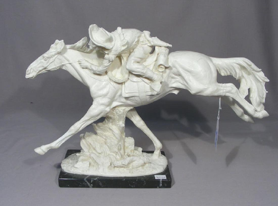 VINTAGE COMPOSITION SCULPTURE OF MAN RIDING HORSE