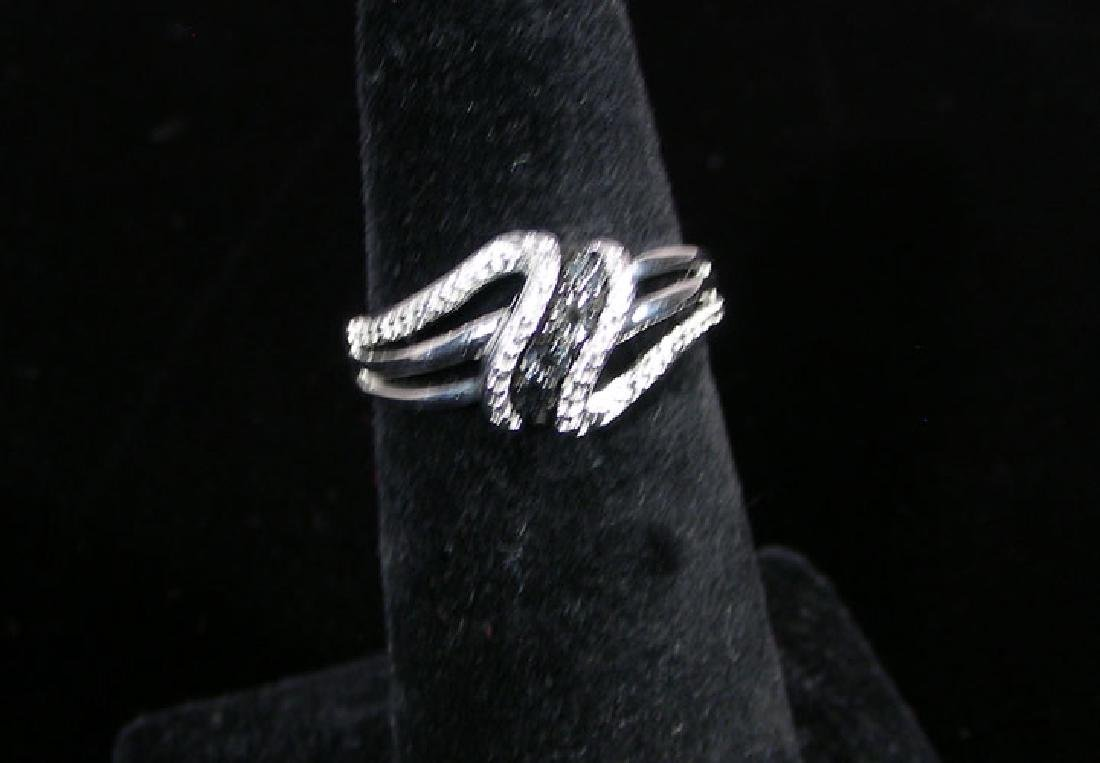 LADIES STERLING SILVER AND BLACK DIAMOND RING