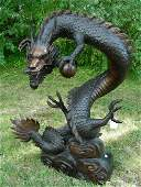 VERY LARGE BRONZE SCULPTURE OF COILED DRAGON