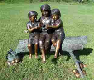 ADORABLE BRONZE SCULPTURE OF THREE CHILDREN SEATED ON